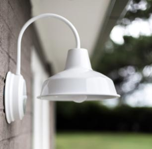 White Hampton Styled Wall Sconce on Brick Wall