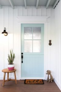 Pale blue door with white vertically ribbed walls