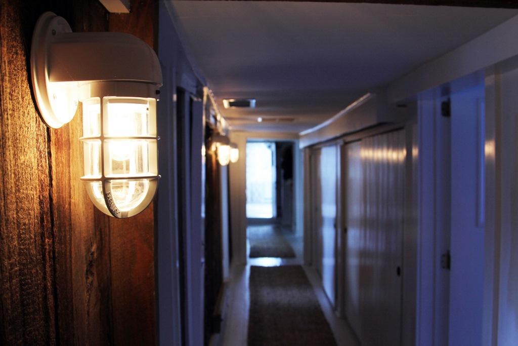 Closeup of our Streamline Moderne Sconce in a converted dairy barn.